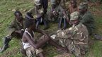 Ex-M23 fighters play cards in Bihanga Training School, Uganda - Friday 7 February 2014