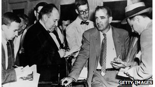 Joseph McCarthy talks to reporters, 1953