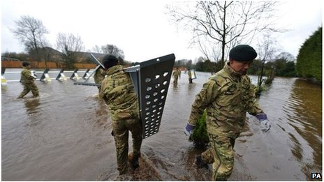 Soldiers put up a dam in a field