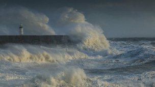 Atlantic storm batters the south coast light house and the harbour of Newhaven on February 14, 2014 in Newhaven, United Kingdom.