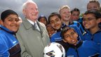 Sir Tom Finney with young footballers