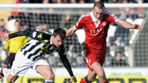 St Mirren striker Paul McGowan (left) is closed down by Andrew Considine