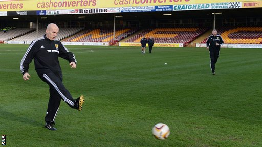 Referee Stephen Finnie inspects the Fir Park pitch