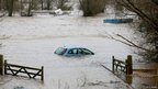 A car sits in flood water