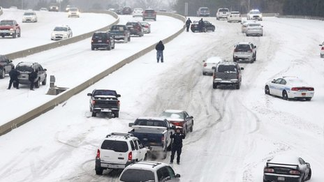 Motorists struggle up a hill in Charlotte, North Carolina