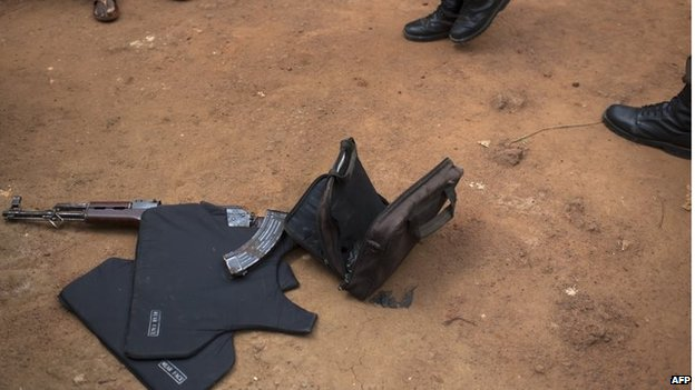 An assault rifle, ammunition, a bag of grenades and a flak jacket on the ground after peacekeepers found them during a search and disarmament operation in Bangui on 7 February