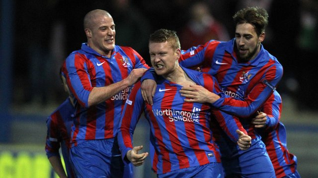 Ards players celebrate victory over Glentoran