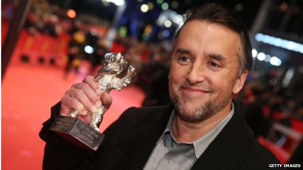 Director Richard Linklater poses with his Silver Bear for Best Director