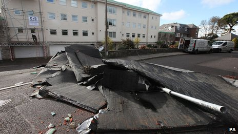 Roof from block of flats in Poole, Dorset, after it was blown off during storms on Friday 14 February 2014