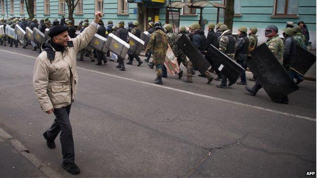 A man salutes Ukrainian opposition protestors
