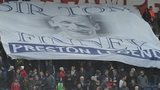 Fans hold a banner in tribute to Sir Tom Finney