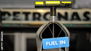 A 'Fuel in' sign hangs on the car of Mercedes GP's German driver Nico Rosberg in the pits at the Bahrain international circuit on March 13, 2010 in Manama, during the third free practice.