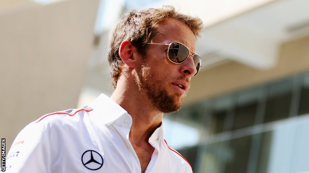ABU DHABI, UNITED ARAB EMIRATES - NOVEMBER 03: Jenson Button of Great Britain and McLaren attends the drivers parade before the Abu Dhabi Formula One Grand Prix at the Yas Marina Circuit on November.