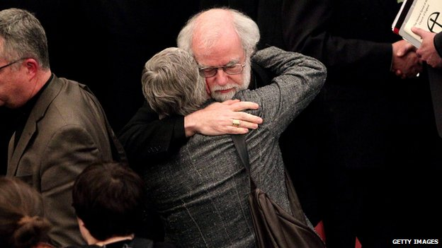 Then Archbishop of Canterbury Rowan Williams consoles a colleague after the House of Laity voted against women bishops in 2012
