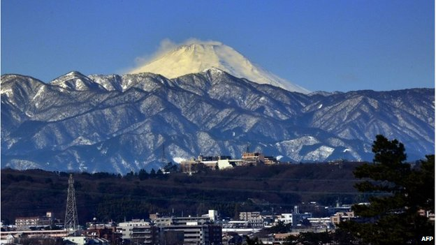 Snow covered Mount Fuji is seen from Tokyo on February 16, 2014 after a snow storm hit Japan
