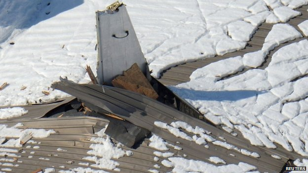 The tail of an aircraft pokes through a collapsed hangar belonging to Nippi Corp., a Kawasaki Heavy Industries Group subsidiary, after heavy snowfalls in Yamato, south of Tokyo in this February 16, 2014 picture provided by Kyodo