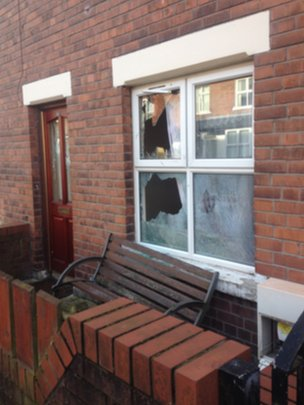 The windows of the house were smashed in the overnight attack
