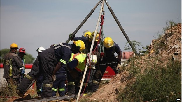 Emergency workers attempt to free trapped illegal miners at a disused gold mine shaft near, Benoni, Feb. 16