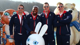 John Jackson, Joel Fearon, Stuart Benson and Bruce Tasker of the Great Britain Bobsleigh team pose with the mascots at the Rosa Khutor mountain village cluster on