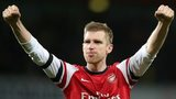 Arsenal defender Per Mertesacker celebrates their FA Cup victory over Liverpool
