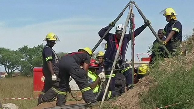 Rescue teams working at the top of the shaft on Sunday