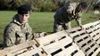Members of the 2nd Royal Tank Regiment build flood defences in Staines