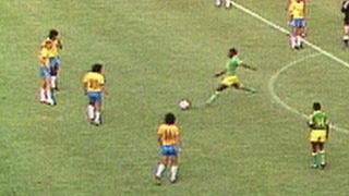 Zaire's Mwepu Ilunga kicks the ball away against Brazil