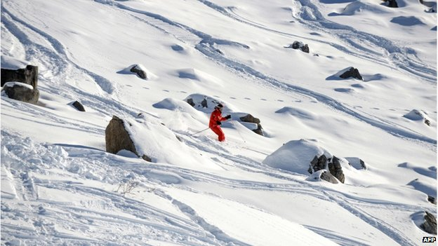 A man skiing in the French Alps ski resort of Meribel next to the rocky part between two slopes where German retired Formula One legend Michael Schumacher had an accident on December 29 (31 Dec 2013)