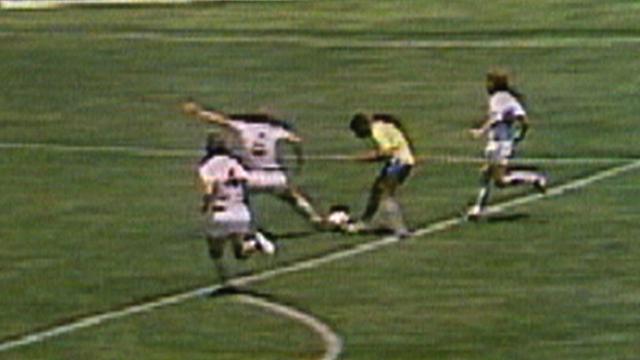 England's Bobby Moore tackles Jairzinho of Brazil