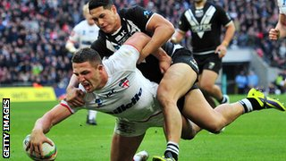 England's Sam Burgess (L) scores a try during the 2013 Rugby League World Cup semi-final match between England and New Zealand at Wembley Stadium in London on November 23, 2013.
