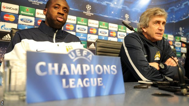 Manchester City manager Manuel Pellegrini (right) and midfielder Yaya Toure
