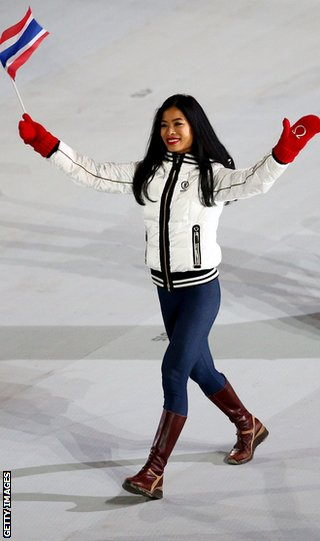 Skier Vanessa-Mae of Thailand waves to the crowd during the opening ceremony