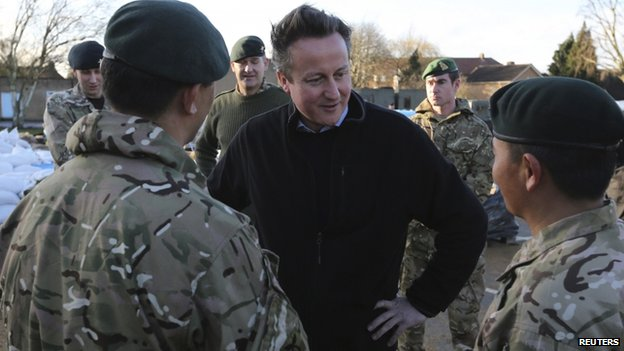 David Cameron meets soldiers from the 2nd battalion Royal Gurkha Rifles, at a military command centre in Chertsey