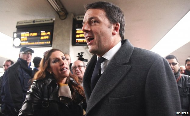 Matteo Renzi talks to a woman at Florence railway station (17 Feb)