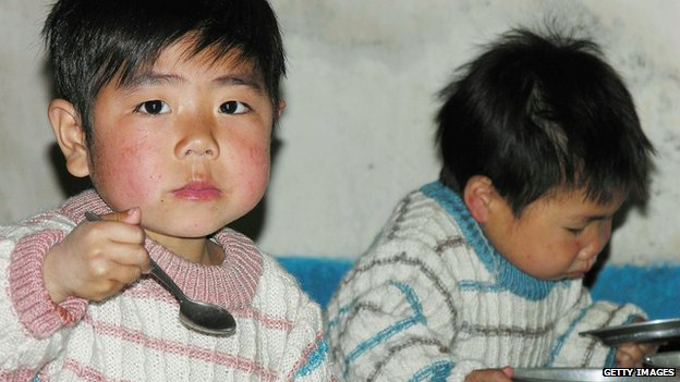 In this handout from the United Nations, North Korean boys eat lunch in a government-run nursery, on 20 April 2005 in Sariwon city, North Hwanghae province, North Korea.