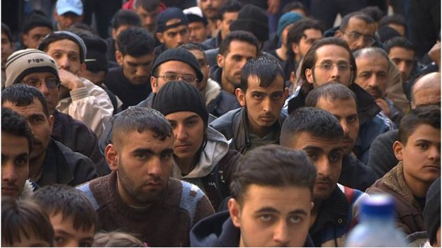 Men inside the detention centre at Homs