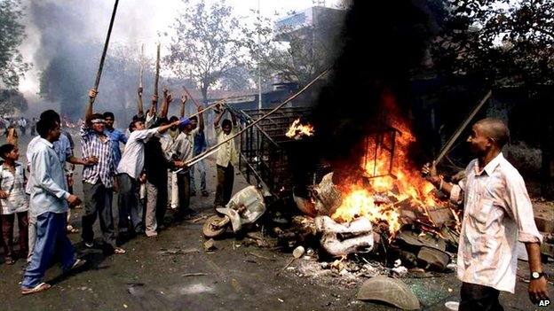 Youths burn vehicles and debris during riots in Ahmadabad, Gujarat, on 28 February, 2002.