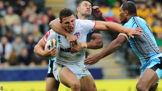 Sam Burgess (centre) is tackled by Fiji's Daryl Millard and Petro Civoniceva