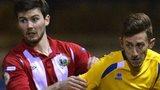 Warrenpoint defender Darren King in action against Bangor's Jordan Forsythe