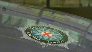 PSNI crest on car bonnet