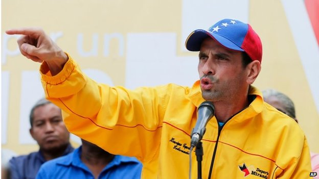 Opposition leader Henrique Capriles speaks during a news conference in Caracas on 16 February, 2014.