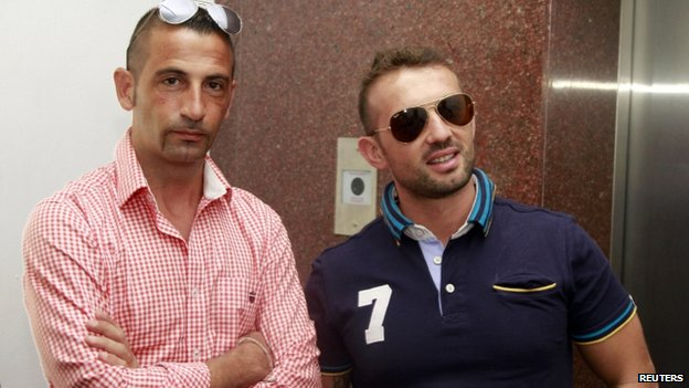 File pic of Massimiliano Latorre (L) and Salvatore Girone (Dec 2012)