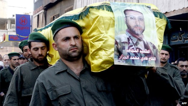 Members of Hezbollah carry the coffin of Fadi Mohammed al-Jazzar during his funeral in southern Beirut on 20 May 2013
