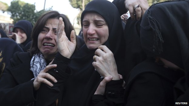 Ali Khadra's mother (centre) cries at his funeral
