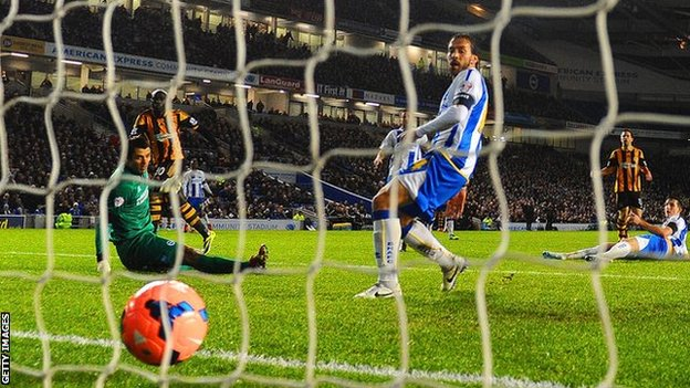 Yannick Sagbo (second left) scores a late equaliser for Hull in their 1-1 draw with Brighton in the FA Cup fifth round