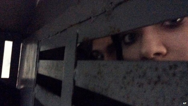 Maria Alyokhina in the back of a police detention vehicle after she and several others were detained in Sochi (18 February 2014)
