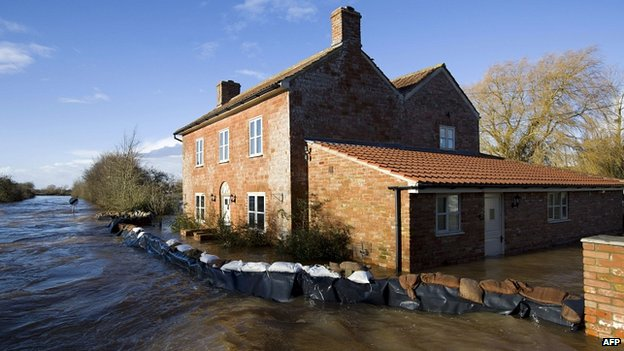 A house surrounded by flood water in Burrowbridge, Somerset