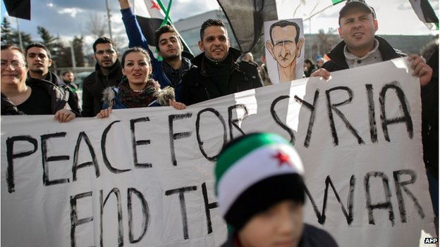 Demonstrators in Geneva, Switzerland, call for an end to the Syrian war