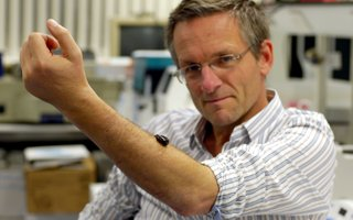 Michael Mosley with a leech on his arm