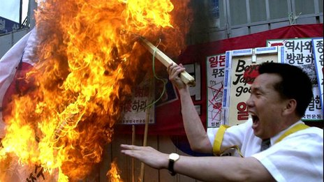 Tensions run high at a protest in South Korea against Japanese textbook
